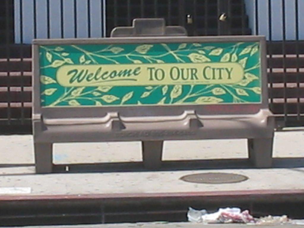 Recentering El Pueblo Bus Bench Ad